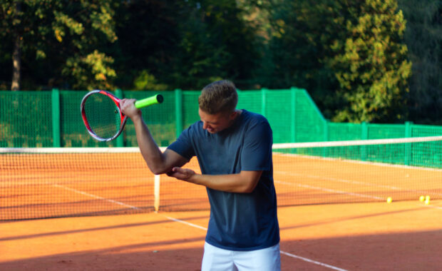 Tennis player with tennis elbow pain