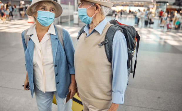 older couple traveling for the holidays with chronic pain