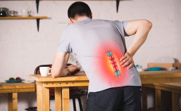 man with lower back pain, herniated discs