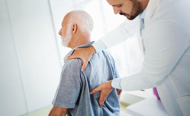 man and doctor with lumbar radiculopathy