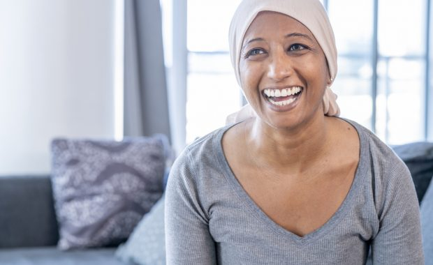 woman smiling with cancer pain