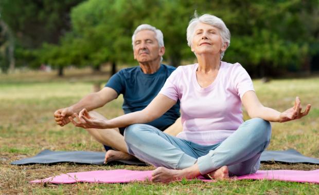 older couple yoga pain relieving techniques
