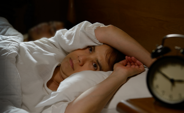 woman with chronic pain and insomnia