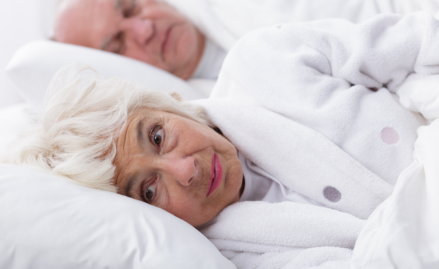 arthritis pain affects older woman sleeping